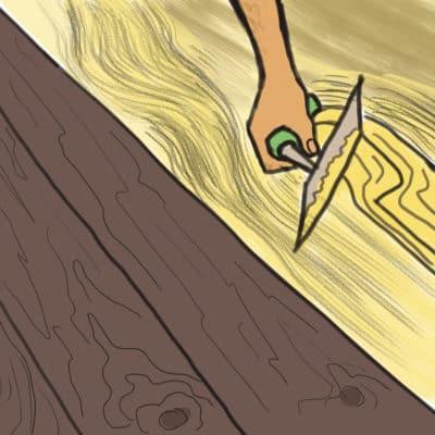 Pose de la colle en dessosu d'un parquet collé à l'aide d'une spatule